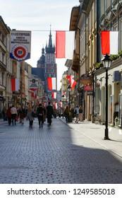 KRAKOW, POLAND - OCTOBER 31, 2018: People walking on pedestrian Florianska Street in Krakow, Poland