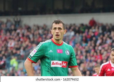 KRAKOW, POLAND - OCTOBER 6: Tomasz Jodlowiec (Legia Warsaw defender) during the football match between Wisla Krakow and Legia Warsaw, 1:1 on October 6, 2013 in Krakow, Poland.