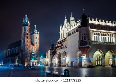 Krakow, Poland - October 8, 2018:  St. Mary's Basilica (Church of Our Lady Assumed into Heaven) and Cloth Hall in Krakow, Poland at night