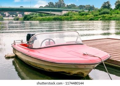 KRAKOW, POLAND - SEPTEMBER 01, 2018: Small motorboat on Wisla river in Krakow, Poland.