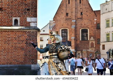 KRAKOW, POLAND - SEPTEMBER 1, 2016. Woman wearing costume and performing in the Rynek Glowny Square, Krakow, Poland.
