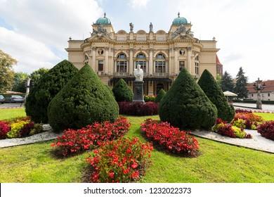 KRAKOW, POLAND - SEPTEMBER 9, 2018: Juliusz Slowacki Theatre, 19th century eclectic building, flowerbed