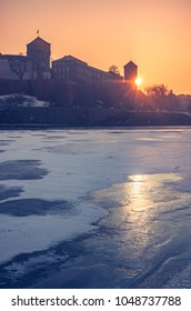 Krakow, Poland, Wawel Castle and Wawel cathedral in the winter over frozen Vistula river, sunrise