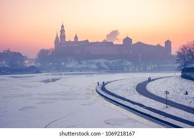 Krakow, Poland, Wawel Castle and Wawel cathedral in the winter over frozen Vistula river in the morning