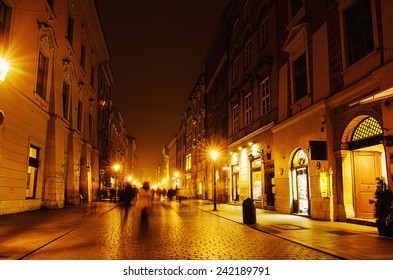 Krakow street in the center of city at night