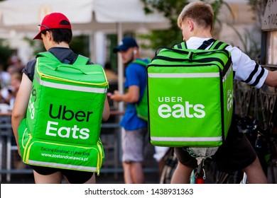 Krakow/Poland June 30, 2019  An Uber Eats courier delivers food in Krakow, Poland
