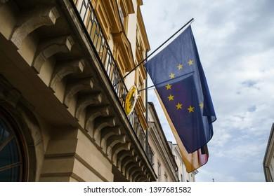 KRAKOW,POLAND-23 APRIL,2019: European Union flag on facade of Bundesrepublik Deutschland Embassy in Polish town Krakow.Flags on German consulate in Poland
