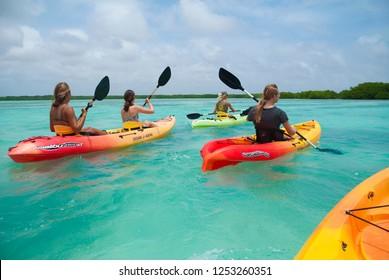 Kralendijk / Bonaire - April 15, 2017: A groep of tourists sets off for a guided kayak tour in the Lac Bai Mangrove Reserve on Bonaire, Caribbean