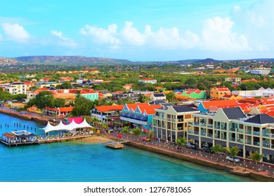 Kralendijk, Bonaire, Caribbean - February 22nd 2018: A view from the top of a cruise ship docked in port, of Kralendijk the capital of Bonaire, and the surrounding landscape.