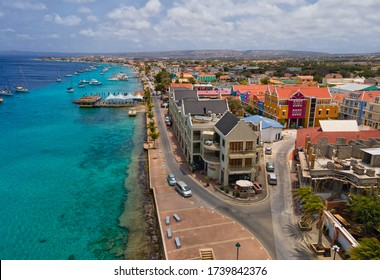 Kralendijk, Bonaire - May 24-05-2020: Skyline of Kralendijk the main city on Bonaire. The boulevard is in the night busy with people drive there cars, and people who are walking.