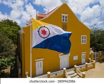 Kralendijk, Bonaire - September  06-2020: Bonaire Flag waving in front of the Lieutenant Governor office during Dia di Boneiru.