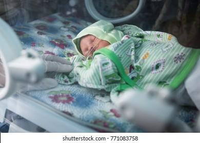 KRAMATORSK, UKRAINE - April 9, 2016: A premature baby in an incubator in intensive care unit in the maternity hospital in Kramatorsk, Donetsk region, Ukraine.