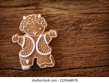 Krampus gingerbread cookies on wooden background