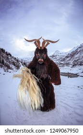 Krampus will coming. Apine mountains with snow on background.