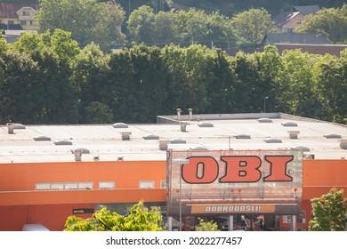 KRANJ, SLOVENIA - JUNE 15, 2021: Obi Baumakrt logo in front of one of their hardware stores in kranj. Obi is a German chain of DIY, home improvement  Hardware stores spread in central Europe.