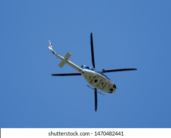 Kranjska Gora / Slovenia - August 3rd 2019: Slovenian Police helicopter Agusta Bell AB-412, S5-HPA, returning from mountain rescue mission in Kranjska Gora, taking patient to General Hospital Jesenice