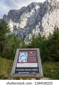 KRANJSKA GORA, SLOVENIA - SEPTEMBER 9th 2018: Information panel describing the The Pagan Girl ( Ajdovska deklica) a face in the northern wall of Prisank, with the feature in the background