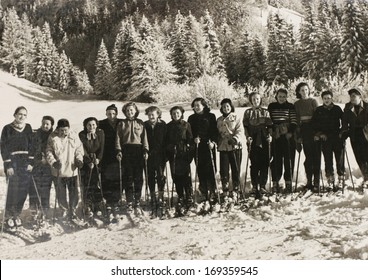 KRANJSKA GORA, YUGOSLAVIA (SLOVENIA) - circa 1950: Vintage photo of a group of women skiing. Slovenia is the home of oldest skiing in central Europe.  Picture has many scratches, artifacts and fading.