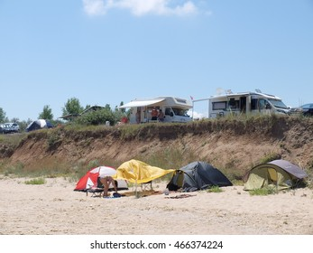 KRAPETS, BULGARIA, JULY 16, 2016: People are enjoying sunny summer on a wild natural beach in Krapets village, which is one of the best spots for summer vacation for tent, camper or hotel lovers.
