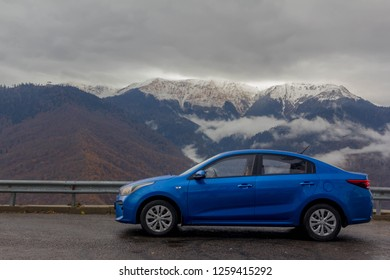 Krasnaya Polyana, Krasnodar region. Russia, November 25, 2018: Blue Kia Ceed on the backdrop of the Caucasus mountains