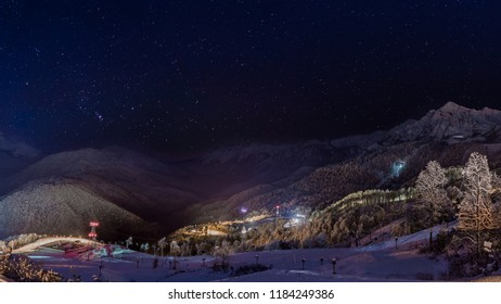 Krasnaya polyana mountains landscape shoot at night at winter time. Long exposure and HDR. Sochi, Russia