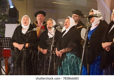 Krasno nad Kysucou, Slovakia. 2017/12/26. Music by the folk band 'Folklorna skupina Vrabciar' singing during the Christmas benefit concert 'V Slovenskom Betleheme' (In Slovakian Bethlehem).