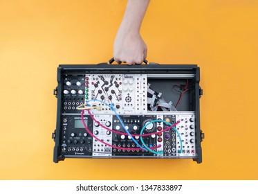Krasnodar/ Russia, 03.24.2019: Small analog eurorack DIY modular synthesizer, head by hand.