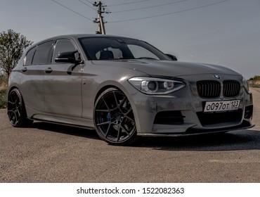 Krasnodar, Russia - 10 4 2019: Gray BMW M135 on a country-side road