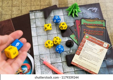Krasnodar, Russia, 14 September 2018: Playing Dungeons and Dragons fantasy role play game. Dices, cards; hand throwing d6 dices. Board games.
