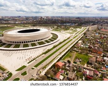KRASNODAR, RUSSIA - April 15, 2019: Krasnodar cityscape and stadium FC Krasnodar from aerial view. Modern european city view