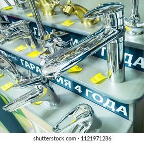 Krasnodar, Russia - december 07, 2017: water taps displayed at sanitary-ware manufacturer's exposition. LeMark, Chech republic