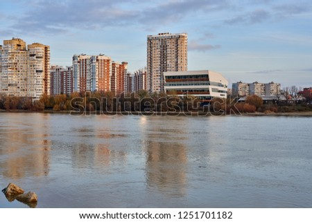 Krasnodar, Russia - December 2, 2018: JK Novyj Gorod. Gorgeous autumn view of the complex of residential buildings with all the infrastructure. Houses are reflected in the water surface of the Kuban