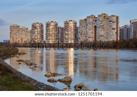 Krasnodar, Russia - December 2, 2018: JK Novyj Gorod. Very beautiful autumn view of the complex of residential buildings with all the infrastructure at the golden hour. Houses are reflected