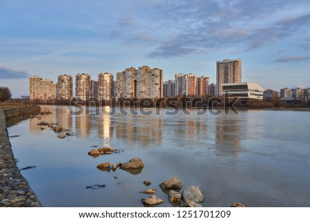 Krasnodar, Russia - December 2, 2018: JK Novyj Gorod. Magnificent autumn view of the complex of residential buildings with all the infrastructure in the golden hour. Houses are reflected in the water