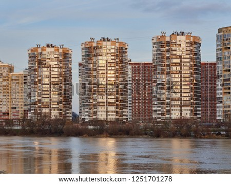 Krasnodar, Russia - December 2, 2018: JK Novyj Gorod. Very beautiful autumn view of the complex of business class residential buildings with all the infrastructure. Houses are reflected in the water