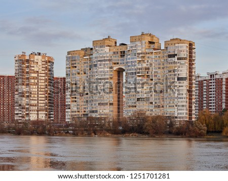 Krasnodar, Russia - December 2, 2018: JK Novyj Gorod. Beautiful autumn view of the complex of residential buildings with all the infrastructure. Houses are reflected in the water surface of the Kuban