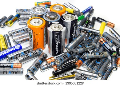 Krasnodar, Russia - February 4, 2019: Saline and alkaline batteries, energy source for portable technology. AAA and AA batteries