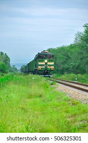 Krasnodar, Russia - July 06, 2015: Green modern locomotive of a freight train carries a train of wagons on the North Caucasus Railway