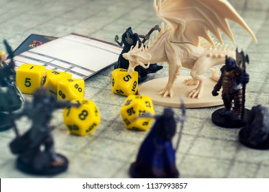 Krasnodar, Russia, July 19, 2018: Playing Dungeons and Dragons. Miniature fugures of rpg characters, skeleton in a cloack holding a sythe, dices and dragon. Board games.