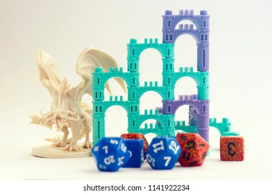 Krasnodar, Russia - July 25, 2018: Playing board game 'Elven Castle'; dragon, elven castle, dices