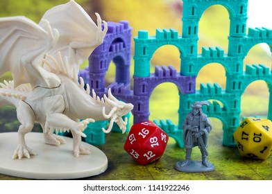 Krasnodar, Russia - July 25, 2018: Playing board game 'Elven Castle'; dragon, character, elven castle, dices for rpg, dnd or tabletop games