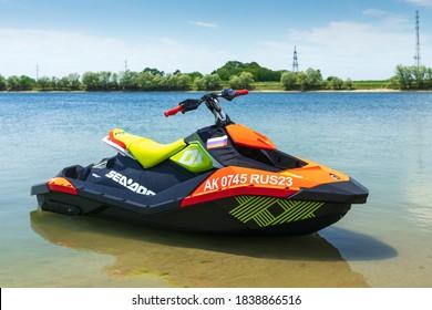 Krasnodar, Russia - July 25, 2020: BRP Sea-Doo jet ski watercraft on still water by river bank