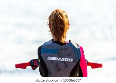 Krasnodar, Russia - July 25, 2020: Jet ski watercraft woman driver back view