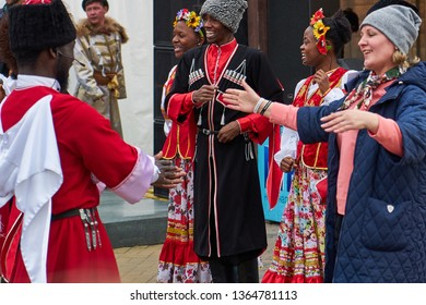 Krasnodar. Russia, March 9, 2019. Pushkin Square. Holiday Maslenitsa. Artists in national costumes sing folk songs. The audience is dancing.