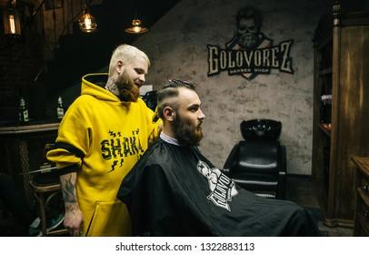 71f2d5c0e Krasnodar, Russia - May 5, 2018 - a stylish barber with tattoos makes a