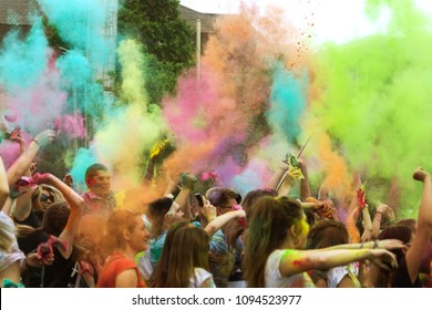 KRASNODAR, RUSSIA - May11,2018: Festival of colors, traditional Indian festival of Holi. Young people have fun during Holi holiday, throwing colorful powder. Festival of colored paint. Color festival