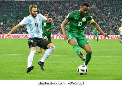 KRASNODAR, RUSSIA - November 14, 2017: John Mikel Obi (R) against  German Pezzella during a friendly match between the national teams of Argentina and Nigeria, 2017, Russia