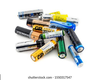KRASNODAR, RUSSIA OCTOBER 1, 2019: AA batteries of different firms on a white background.
