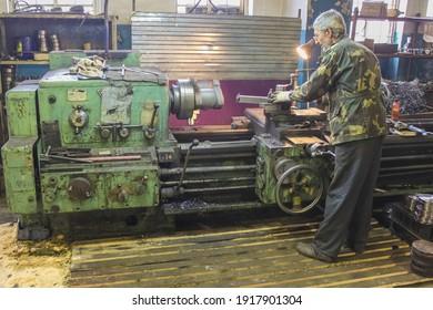 Krasnodar, Russia - October 10, 2011: The turner works on a large old Soviet lathe