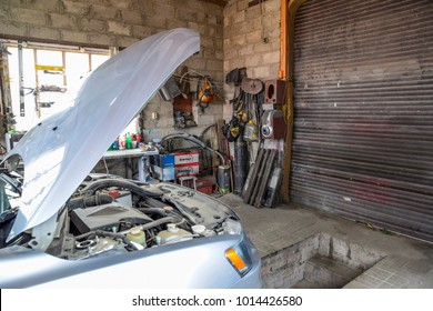 Krasnodar, Russia - October 18, 2017: A car with an open hood in the garage. Tools and repair.